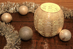 Still life of Christmas tinsel. Balls and bowls with candles Royalty Free Stock Image
