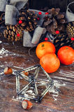 Still life Christmas wreath and tangerines. Christmas ornament toy octahedron,tangerines and pine cones Stock Photo