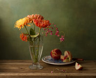 Still life with chrysanthemum flowers and peaches Stock Photo