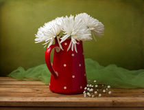 Still life with chrysanthemum flowers in red jug Royalty Free Stock Images