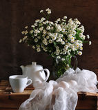 Still life with chrysanthemums and eggs royalty free stock image