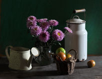 Still life with chrysanthemums and tomatoes Stock Photo