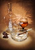 Still life with cigar and cognac Stock Photos