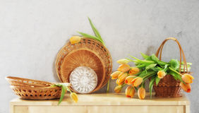 Still Life Circles. Still life with decorative items made of straw and tulips royalty free stock photo