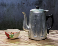 Still life classic kettle with cup and lamp Royalty Free Stock Photo