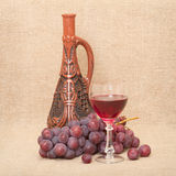 Still-life with clay bottle, grapes and glass Royalty Free Stock Photo