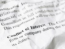 Still life close up shot of Conflict of Interest word message on. Crumpled and wrinkled contract paper stock images