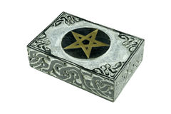 Still life with closed stone esoteric mystic box with carved sign pentagram and ornaments isolated stock photo