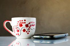 Still life Coffe cup and phone Royalty Free Stock Photography
