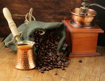 Still life coffee beans in a bag and copper pot Royalty Free Stock Images