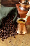 Still life coffee beans in a bag and copper pot Royalty Free Stock Photos