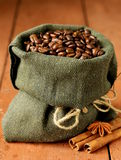 Still life of coffee beans in canvas sack Stock Images
