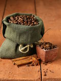 Still life of coffee beans in canvas sack Royalty Free Stock Images