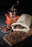 Still life of coffee beans in jute bags with coffee grinder Stock Images