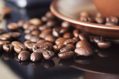 Still life with coffee beans and old coffee mill on the wooden background Royalty Free Stock Photo