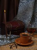 Still life. Coffee, candle, alcohol. Stock Photo
