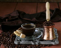 Still life coffee cup espresso beans and coffee pot Stock Photography