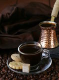 Still life coffee cup espresso beans and coffee pot Stock Photos