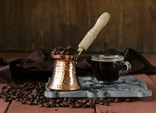 Still life coffee cup espresso beans and coffee pot Royalty Free Stock Images