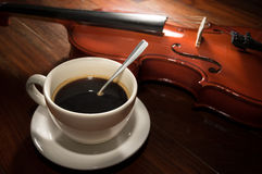 Still life coffee cup with violin. Royalty Free Stock Photo