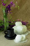 Still life with coffee, flowers and white marshmallows Stock Images
