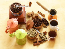 Still life of coffee - green and brown beans and spices Royalty Free Stock Photo