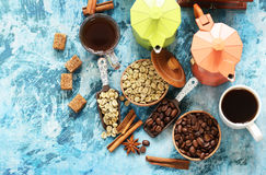 Still life of coffee - green and brown beans and spices Stock Image