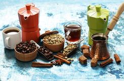 Still life of coffee - green and brown beans and spices Royalty Free Stock Images