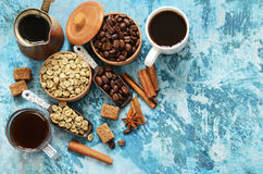 Still life of coffee - green and brown beans and spices Stock Photos