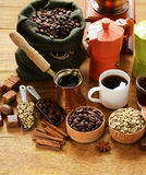 Still life of coffee - green and brown beans and spices Stock Images