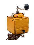 Still life with coffee and grinder. Antiquity coffee machine with beans Royalty Free Stock Photos