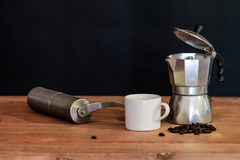 Still life coffee maker and cup. On table royalty free stock images