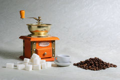 Still-life with coffee mill. Sugar and coffee beans Stock Photos