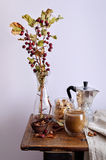 Still life with coffee, nuts and small apples Royalty Free Stock Photos