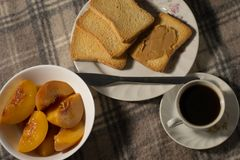 Still life with coffee. Peaches and toasts royalty free stock photography