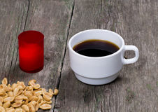 Still life coffee, red candle and peanut Royalty Free Stock Photography