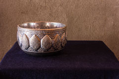 Still life of Cold water in silver water bowl of Thai style Royalty Free Stock Photo