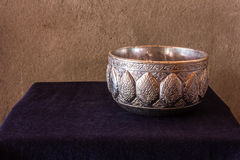 Still life of Cold water in silver water bowl of Thai style Stock Photos