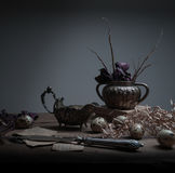 Still life. collection of antique silver items on a wooden table. black background Royalty Free Stock Photography
