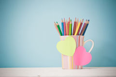 Still life color pencils in colorful cup Stock Images