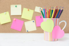 Still life color pencils in colorful cup Royalty Free Stock Photos