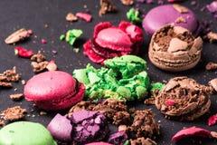 Crumbed Macaroons on dark background. Still life with Colored Crumbed Macaroons on a dark background stock photo
