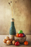 Still life colorful Easter eggs basket vase royalty free stock photo
