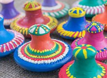 Still life of colorful painted pottery lids on sackcloth backgro Royalty Free Stock Images