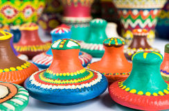 Still life of colorful painted pottery lids on white background Stock Images