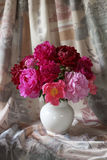 Still life with colorful peonies Stock Photo