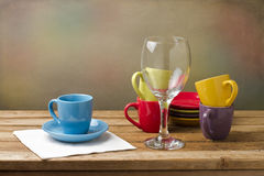 Still life with colorful tableware. On wooden table over grunge background Royalty Free Stock Photography