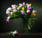 Still life with colorful tulips. On stone table Royalty Free Stock Images