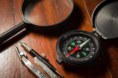 Still life compass with magnifier . Royalty Free Stock Images