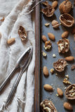 Still life composition with cracked walnuts and almonds Stock Images